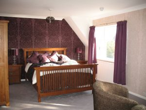 Premier Room has kingsize bed and view of gardens